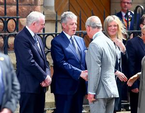 Prince Charles is greeted by Martin McGuinness and Peter Robinson at St Patrick's Church, Donegall Street, Belfast.