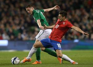 Serbia's Dusan Tadic (right) and Republic of Ireland's James McCarthy during the international friendly at The Aviva Stadium, Dublin. Pic Brian Lawless/PA Wire