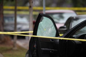 SANTA MONICA, CA - JUNE 07:  A bullet hole is seen in a bullet-riddled crashed car in which a woman was reportedly shot, near a burning home with two bodies inside, after multiple shootings were reported at various locations including Santa Monica College June 7, 2013 in Santa Monica, California. According to reports, at least six people have been injured, and a suspect was taken into custody.  (Photo by David McNew/Getty Images)