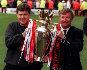 File photo dated 05/05/1996 of Manchester united manager alex ferguson (right) and assistant manager brian kidd hold the premiership trophy after their side beat middlesbrough to win the title at riverside stadium. PRESS ASSOCITAION Photo. Issue date: Wednesday May 8, 2013. Sir Alex Ferguson will retire at the end of this season, Manchester United have announced. See PA Story SOCCER Man Utd. Photo credit should read: John Giles/PA Wire.