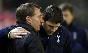 Liverpool manager Brendan Rodgers and Tottenham Hotspur manager Mauricio Pochettino during the Barclays Premier League match at Anfield, Liverpool.