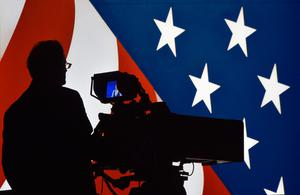 A television cameraman tests his equipment prior to showtime at the  Thomas & Mack Center on the campus of the University of Las Vegas, Nevada, where the final debate between US presidential nominees Democrat Hillary Clinton and Republican Donald Trump will be held October 19, 2016. / AFP PHOTO / PAUL J. RICHARDSPAUL J. RICHARDS/AFP/Getty Images