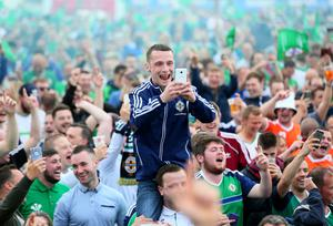 Picture - Kevin Scott / Presseye  Belfast, UK - February 12 , Pictured is fans during the Northern Ireland fan zone in association with Vauxhall held at the Titanic Slipways as Northern Ireland take on Poland in the Euros on February 12, 2016 in Belfast, Northern Ireland ( Photo by Kevin Scott / Presseye)
