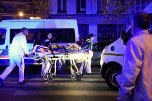 "Rescuers evacuate an injured person on Boulevard des Filles du Calvaire, close to the Bataclan concert hall in central Paris, early on November 14, 2015. A number of people were killed in an ""unprecedented"" series of bombings and shootings across Paris and at the Stade de France stadium on November 13, and the death toll looked likely to rise as sources said dozens had been killed at the Bataclan popular music venue. AFP PHOTO / MIGUEL MEDINAMIGUEL MEDINA/AFP/Getty Images"
