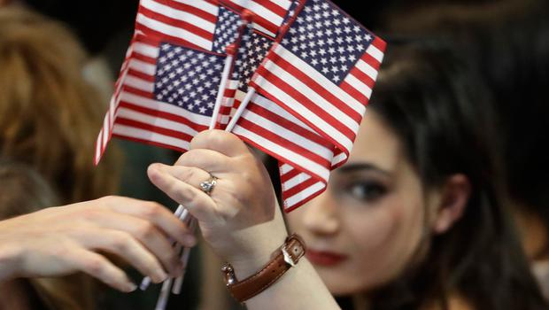 American flags are handed out during Democratic presidential nominee Hillary Clinton's election night rally in the Jacob Javits Center glass enclosed lobby in New York, Tuesday, Nov. 8, 2016. (AP Photo/David Goldman)