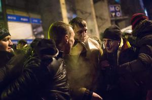 KIEV, UKRAINE - JANUARY 24: Men accused of being paid government thugs from Eastern Ukraine are detained by anti-government protestors in Independence Square on January 24, 2014 in Kiev, Ukraine. Talks to resolve the political stalemate in Ukraine have failed as anti-government protests continue in the capital and opposition leader Vitali Klitschko urges the government to call a snap election. (Photo by Rob Stothard/Getty Images)
