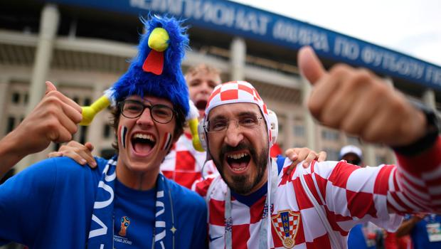 A France's and Croatia's supporter pose ahead of the Russia 2018 World Cup final football match between France and Croatia at the Luzhniki Stadium in Moscow on July 15, 2018. / AFP PHOTO / Kirill KUDRYAVTSEVKIRILL KUDRYAVTSEV/AFP/Getty Images