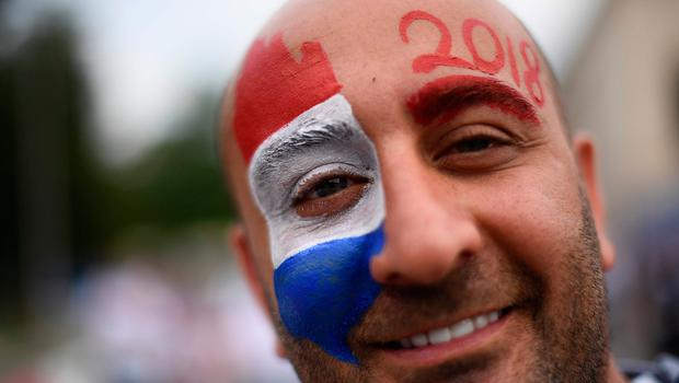 A supporter arrives ahead of the Russia 2018 World Cup final football match between France and Croatia at the Luzhniki Stadium in Moscow on July 15, 2018. / AFP PHOTO / Jewel SAMAD / RESTRICTED TO EDITORIAL USE - NO MOBILE PUSH ALERTS/DOWNLOADS JEWEL SAMAD/AFP/Getty Images