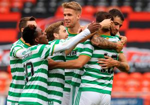 Celtic's Albian Ajeti (front right) celebrates scoring his side's first goal of the game during the Scottish Premiership match at Tannadice Park, Dundee. Credit: Steve Welsh/NMC Pool/PA Wire