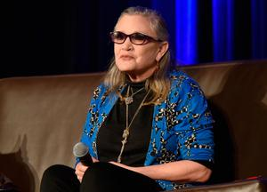 FILE  DECEMBER 23: According to reports December 23, 2016 actress Carrie Fisher suffered a heart attack while on a flight from London to Los Angeles.  She is reportedly at a hospital in Los Angeles. ROSEMONT, IL - AUGUST 21:  Actress Carrie Fisher speaks onstage during Wizard World Comic Con Chicago 2016 - Day 4 at Donald E. Stephens Convention Center on August 21, 2016 in Rosemont, Illinois.  (Photo by Daniel Boczarski/Getty Images for Wizard World)