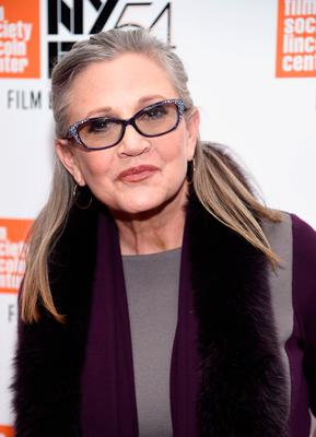 """FILE  DECEMBER 23: According to reports December 23, 2016 actress Carrie Fisher suffered a heart attack while on a flight from London to Los Angeles.  She is reportedly at a hospital in Los Angeles. NEW YORK, NY - OCTOBER 10:  Carrie Fisher attends the 54th New York Film Festival - """"Bright Lights"""" Photo Cal on October 10, 2016 in New York City.  (Photo by Dimitrios Kambouris/Getty Images)"""