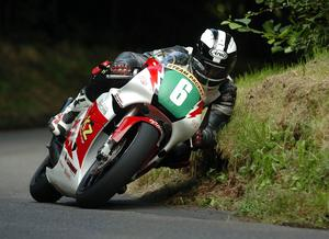 A SOD OFF THE OUL BANK  I think they call this corner on the Mid-Antrim course OHaras Bend. They are usually named after the farmer or some local landmark, often the original inspiration having long since been lost to memory.  But Dunlop is a name synonymous with road racing and this youngster is carrying on a fine tradition that will never be forgotten.  William Dunlop, son of Robert and nephew of Joey, is the latest road racer from the worlds most famous road racing stable.  Roberts other son Michael has also entered the fray and Sam Dunlop, son of Jim, the fourth member of the infamous Armoy Armada, is a roads regular too.  The younger generation have lost none of the older guys style, as William cuts a line so tight at OHaras even the grass has to get out of the way.  Sam Dunlop won the Newcomers 125cc Manx Grand Prix in 2005.  William will compete in the TT for the first time in 2006 to carry on the illustrious Dunlop tradition and keep Ballymoney at the centre of the pure road racing world.  William Dunlop, Mid-Antrim, 2005.