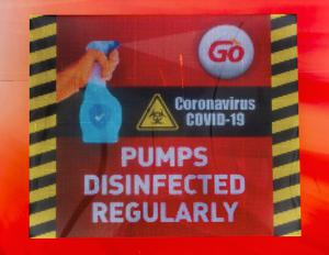 GO Petrol Station in Belfast on Wednesday March 25, 2020, where the owners have displayed a sign notifying customers that the pumps are disinfected regularly to combat Covid-19 Liam McBurney/PA Wire