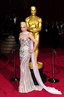 Lady Gaga arriving at the 86th Academy Awards held at the Dolby Theatre in Hollywood, Los Angeles, CA, USA. PRESS ASSOCIATION Photo. Picture date: Sunday March 2, 2014. See PA story SHOWBIZ Oscars. Photo credit should read: Ian West/PA Wire