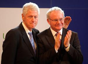 File photo dated 29/09/10 of former US President Bill Clinton with Deputy First Minister Martin McGuinness at the University of Ulster Magee campus in Derry. PA