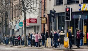 Office workers gather on both sides of Donegall Street following a fire alarm as Belfast goes into its first day of lockdown on March 24th 2020 (Photo by Kevin Scott for Belfast Telegraph)