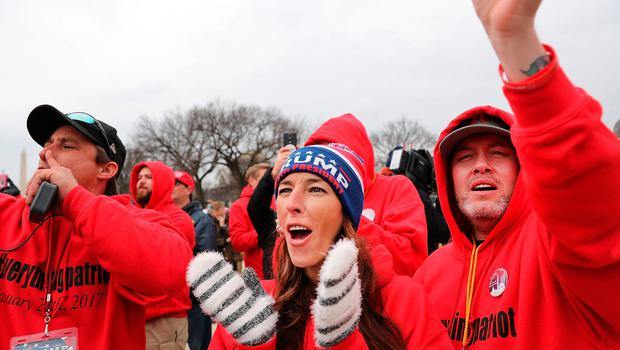 WASHINGTON, DC - JANUARY 20:  US President Donald Trump supporters react on the National Mall to the inauguration of Donald Trump on January 20, 2017 in Washington, DC. Washington and the entire world have watched the transfer of the United States presidency from Barack Obama to Donald Trump, the 45th president.  (Photo by Spencer Platt/Getty Images)