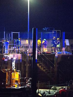 Emergency services on the pier at Buncrana after yesterday's tragic accident