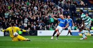 GLASGOW, SCOTLAND - APRIL 17:   Kenny Miller of Rangers scores the opening goal of the game during the William Hill Scottish Cup semi final between Rangers and Celtic at Hampden Park on April 17, 2016 in Glasgow, Scotland.  (Photo by Jeff J Mitchell/Getty Images)