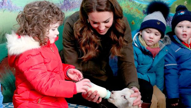 The Duchess of Cambridge helps children feed a lamb some milk during a visit to The Ark Open Farm, at Newtownards, near Belfast, where she is meeting with parents and grandparents to discuss their experiences of raising young children for her Early Childhood survey. PA Photo. Picture date: Wednesday February 12, 2020. See PA story ROYAL Kate. Photo credit should read: Liam McBurney/PA Wire