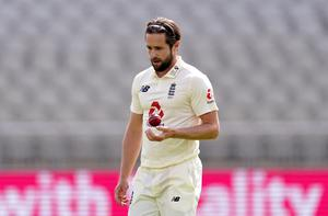 Chris Woakes, hailed as the England squad's 'Mr Dependable' by captain Joe Root, prepares to bowl against the West Indies at Old Trafford.