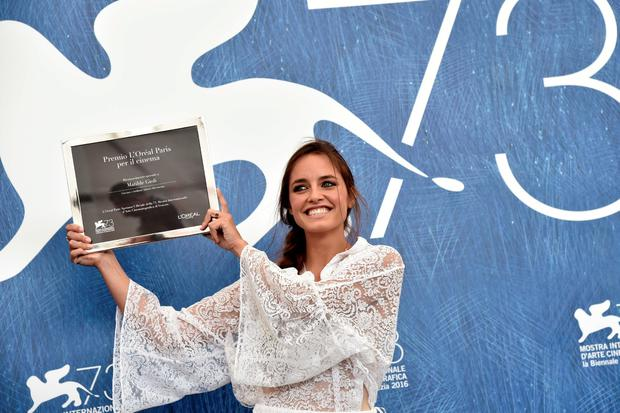 "Italian actress Matilde Gioli poses during a photocall after she received the ""L'Oreal Paris for Cinema Award"" at the 73rd Venice Film Festival on September 7, 2016 at Venice Lido.TIZIANA FABI/AFP/Getty Images"