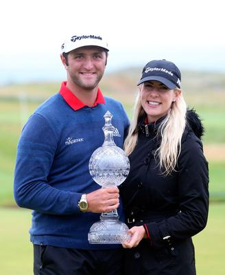Spain's Jon Rahm celebrates winning the Dubai Duty Free Irish Open with girlfriend Kelley Cahill and the trophy at Portstewart Golf Club. PRESS ASSOCIATION Photo. Picture date: Sunday July 9, 2017. See PA story GOLF Irish. Photo credit should read: Niall Carson/PA Wire. RESTRICTIONS: Editorial use only. No commercial use.