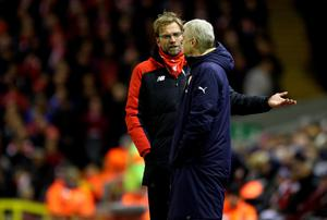 """Liverpool manager Jurgen Klopp (left) and Arsenal manager Arsene Wenger exchange words during the Barclays Premier League match at Anfield, Liverpool. PRESS ASSOCIATION Photo. Picture date: Wednesday January 13, 2016. See PA story SOCCER Liverpool. Photo credit should read: Richard Sellers/PA Wire. RESTRICTIONS: EDITORIAL USE ONLY No use with unauthorised audio, video, data, fixture lists, club/league logos or """"live"""" services. Online in-match use limited to 75 images, no video emulation. No use in betting, games or single club/league/player publications."""