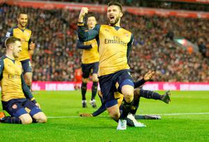 """Arsenal's Olivier Giroud celebrates scoring his side's third goal of the game during the Barclays Premier League match at Anfield, Liverpool. PRESS ASSOCIATION Photo. Picture date: Wednesday January 13, 2016. See PA story SOCCER Liverpool. Photo credit should read: Richard Sellers/PA Wire. RESTRICTIONS: EDITORIAL USE ONLY No use with unauthorised audio, video, data, fixture lists, club/league logos or """"live"""" services. Online in-match use limited to 75 images, no video emulation. No use in betting, games or single club/league/player publications."""