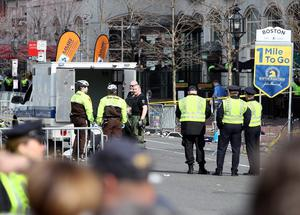 BOSTON, MA - APRIL 15:  Boston Police guard an area at the one mile checkpoint near Kenmore Square after two bombs exploded during the 117th Boston Marathon on April 15, 2013 in Boston, Massachusetts. Two people are confirmed dead and at least 23 injured after two explosions went off near the finish line to the marathon.  (Photo by Alex Trautwig/Getty Images)