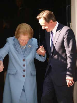 Baroness Thatcher in Downing Street...Prime Minister David Cameron helps Baroness Thatcher as she leaves Downing Street. PRESS ASSOCIATION Photo. Picture date: Tuesday June 8, 2010. Prime Minister David Cameron today welcomed his predecessor Baroness Thatcher to 10 Downing Street for a private meeting. See PA story POLITICS Thatcher. Photo credit should read: Max Nash/PA Wire...A