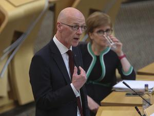 Education Secretary John Swinney gives a statement on SQA exam results at the Scottish Parliament, watched by First Minister Nicola Sturgeon (Fraser Bremner/Scottish Daily Mail/PA)