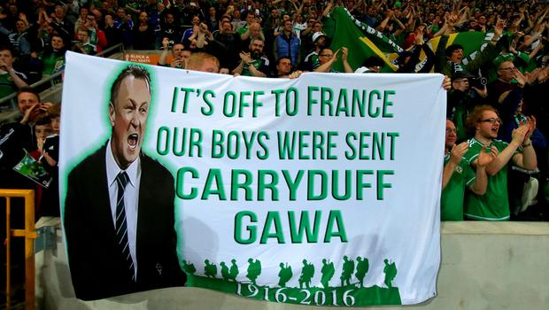Northern Ireland fans display a banner during a celebration send-off before the team leaves for Euro 2016 after the International Friendly at Windsor Park, Belfast. PRESS ASSOCIATION Photo. Picture date: Friday May 27, 2016. See PA story SOCCER N Ireland. Photo credit should read: Niall Carson/PA Wire. RESTRICTIONS: Editorial use only, No commercial use without prior permission, please contact PA Images for further information: Tel: +44 (0) 115 8447447.