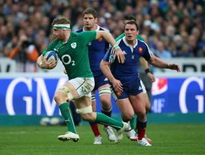 Jamie Heaslip of Ireland makes a break during the RBS Six Nations match between France and Ireland at Stade de France on March 15, 2014 in Paris, France.  (Photo by Julian Finney/Getty Images)