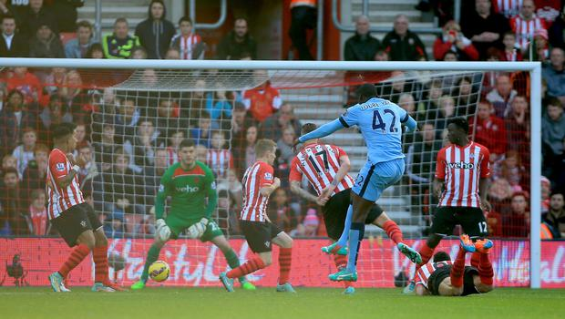 Manchester City's Yaya Toure scores his sides first goal of the game during the Barclays Premier League match at St Mary's Stadium, Southampton. Nick Potts/PA Wire.