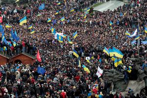 Demonstrators gather during a rally in downtown Kiev, Ukraine, on Sunday, Dec. 1, 2013. As many as 100,000 demonstrators chased away police to rally in the center of Ukraine's capital on Sunday, defying a government ban on protests on Independence Square, in the biggest show of anger over the president's refusal to sign an agreement with the European Union. (AP Photo/Ivan Sekretarev)