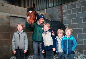 Family joy: Grand National Winner Tiger Roll with stable lass Louise Magee and her sons Thomas, Andrew, Michael and Kieran