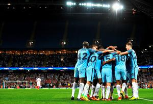 MANCHESTER, ENGLAND - AUGUST 24: Manchester City players celebrate the goal scored by Fabian Delph during the UEFA Champions League Play-off Second Leg match between Manchester City and Steaua Bucharest at Etihad Stadium on August 24, 2016 in Manchester, England.  (Photo by Michael Regan/Getty Images)