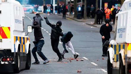 Mini riot: Youths throw projectiles at police on Lanark Way last night