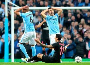 Manchester City's Sergio Aguero shows his frustration after a tackle on Paris Saint-Germain's Angel Di Maria during the UEFA Champions League Quarter Final, Second Leg match at the Etihad Stadium, Manchester. Martin Rickett/PA Wire