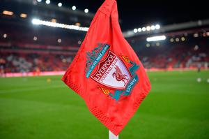 The Liverpool crest sits on a corner flag pole ahead of the English League Cup quarter-final football match between Liverpool and Leeds United at Anfield in Liverpool, north west England on November 29, 2016. AFP/Getty Images