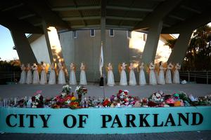 PARKLAND, FL - FEBRUARY 16:  Candles still glow after last nights vigil for victims of the mass shooting at Marjory Stoneman Douglas High School, at Pine Trail Park, on February 16, 2018 in Parkland, Florida. Police arrested 19 year old former studentÊNikolas Cruz for killing 17 people at the high school.  (Photo by Mark Wilson/Getty Images)