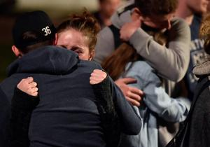 People react during a memorial for those who lost their lives after a balcony gave way in Berkeley, California on June 17, 2015.  Dry rot and overcrowding could be responsible for the collapse of the balcony that sent six young Irish nationals plummeting to their deaths.     AFP PHOTO / JOSH EDELSONJosh Edelson/AFP/Getty Images