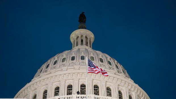 WASHINGTON, DC - JANUARY 20: The American flag flies on the West Front of the U.S. Capitol on January 20, 2017 in Washington, DC. In todays inauguration ceremony Donald J. Trump becomes the 45th president of the United States.  (Photo by Scott Olson/Getty Images)