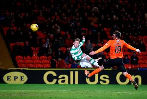 Celtic's Kris Commons (left) scores his side's fourth goal of the game during the Ladbrokes Scottish Premiership match at Tannadice Park, Dundee. Andrew Milligan/PA Wire.