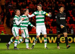 Celtic's Kris Commons (centre left) celebrates scoring his side's fourth goal of the game during the Ladbrokes Scottish Premiership match at Tannadice Park, Dundee. PRESS ASSOCIATION Photo. Picture date: Friday January 15, 2016. See PA story SOCCER Dundee Utd. Photo credit should read: Andrew Milligan/PA Wire. RESTRICTIONS: EDITORIAL USE ONLY