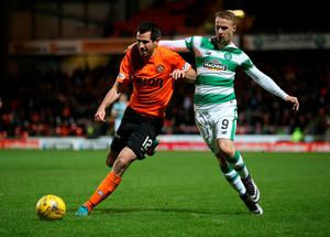 Dundee United's Ryan McGowan (left) challenges Celtic's Leigh Griffith during the Ladbrokes Scottish Premiership match at Tannadice Park, Dundee.  Andrew Milligan/PA Wire