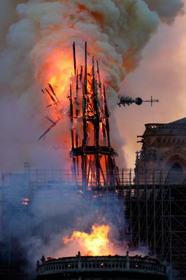 The steeple collapses as smoke and flames engulf the Notre-Dame Cathedral in Paris on April 15, 2019. Photo by Geoffroy VAN DER HASSELT / AFP)GEOFFROY VAN DER HASSELT/AFP/Getty Images