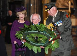 Irish President Michael D Higgins watches with his wife Sabina Coyne, as an Irish solider lays a wreath at the grave of the Unknown Warrior, during a visit to Westminster Abbey on April 8, 2014 in London, England. This is the first official visit by the head of state of the Irish Republic to the United Kingdom.  (Photo by Anthony Harvey/Getty Images)