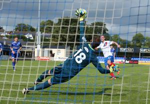 Linfield's Andrew Mitchell scores a penalty past Dungannon Swifts goalkeeper Stuart Addis, who held his place even though Andy Coleman was again available for selection. Picture by Brian Little/PressEye